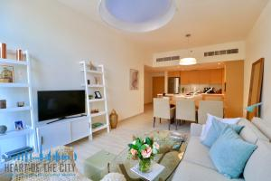 Living room in apartment for sale in Belgravia by Ellington at JVC in Dubai