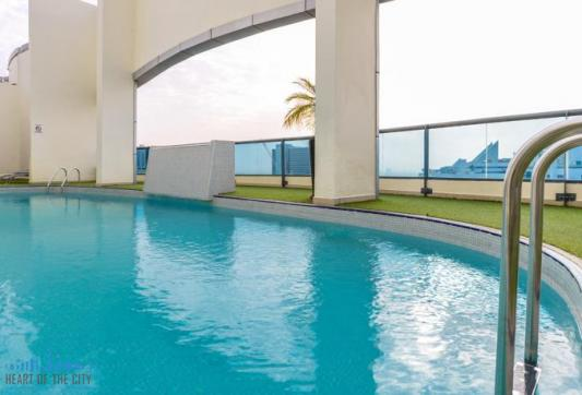 Swimming pool in The First Central Hotel Apartment